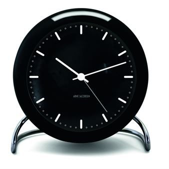The elegant AJ City Hall table clock comes from the Danish brand Rosendahl Copenhagen and is a part of the Timepiece series. The clock is designed by Arne Jacobsen and has a classic design in black that fits most homes and environments. The clock is perfect to give away as a gift and is both a practical and stylish interior detail. Combine it together with other fine products from Rosendahl Copenhagen to decorate your home with!