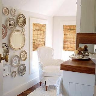 wicker and white, transferware walls, white slipcovered chairs, bamboo roman shades