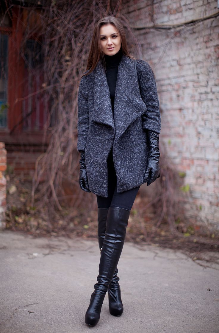 Wear a dark grey coat with black leggings for a standout ensemble. Black leather over the knee boots will bring a classic aesthetic to the ensemble.