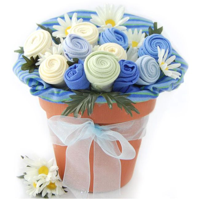 This Nikki's Baby Blossoms is a fun and unique way to say congratulations to the new parents. This gift bouquet features five adorable bibs, three ultra-soft washcloths, a cute onesie and a baby blanket rolled to look like a bouquet of fresh flowers.