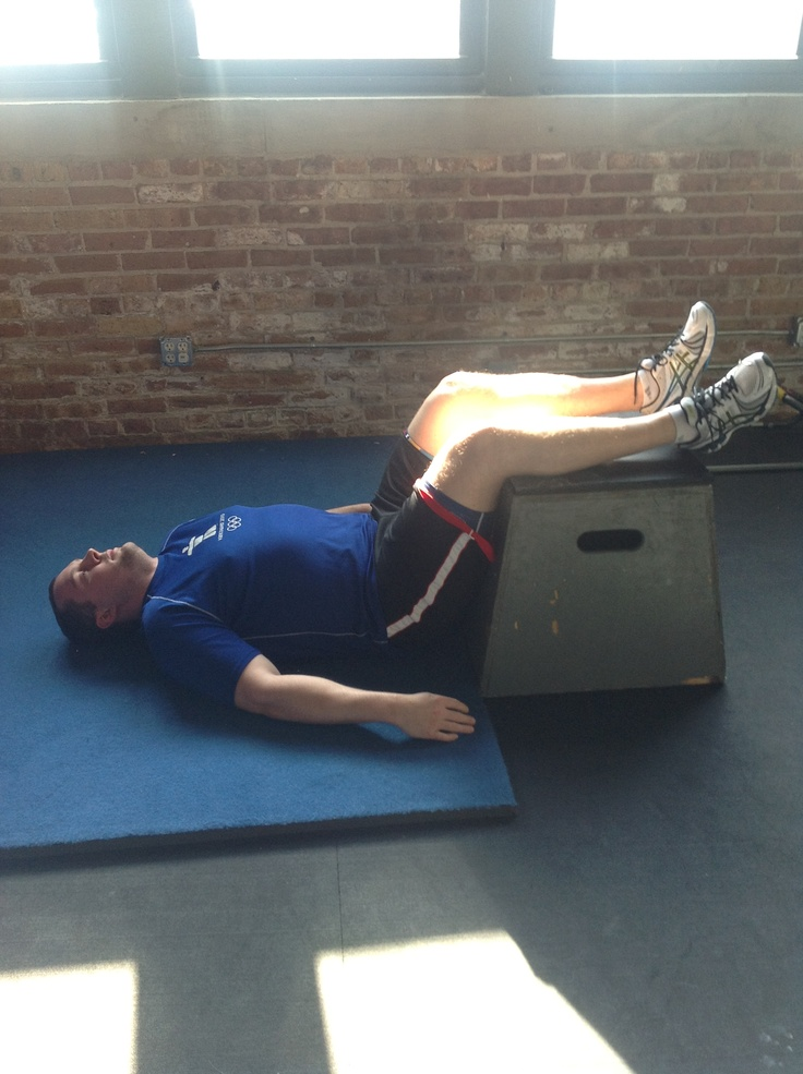Low back decompression with 2 lacrosse balls:  lie on  back with feet on small box, place 2 taped balls at low back and massage gently.