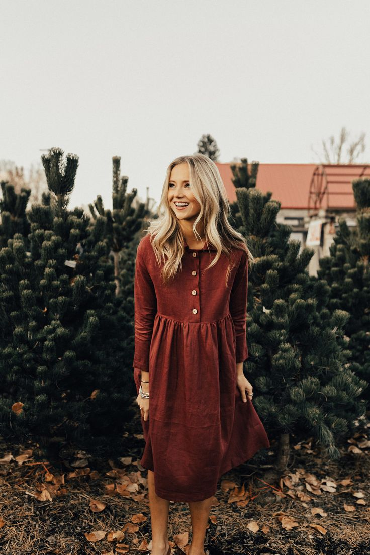 """Burgundy Babydoll Dress ROOLEE Exclusive Design Functional Button Up Front Gathered Babydoll Waist Loose, Long Sleeves Hidden Hip Pockets Collared Neckline Nursing Friendly View Size Chart Model is 5'9"""" + Wearing a Small"""