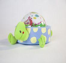 Proyector luminoso con forma de tortuga dulce y divertida.