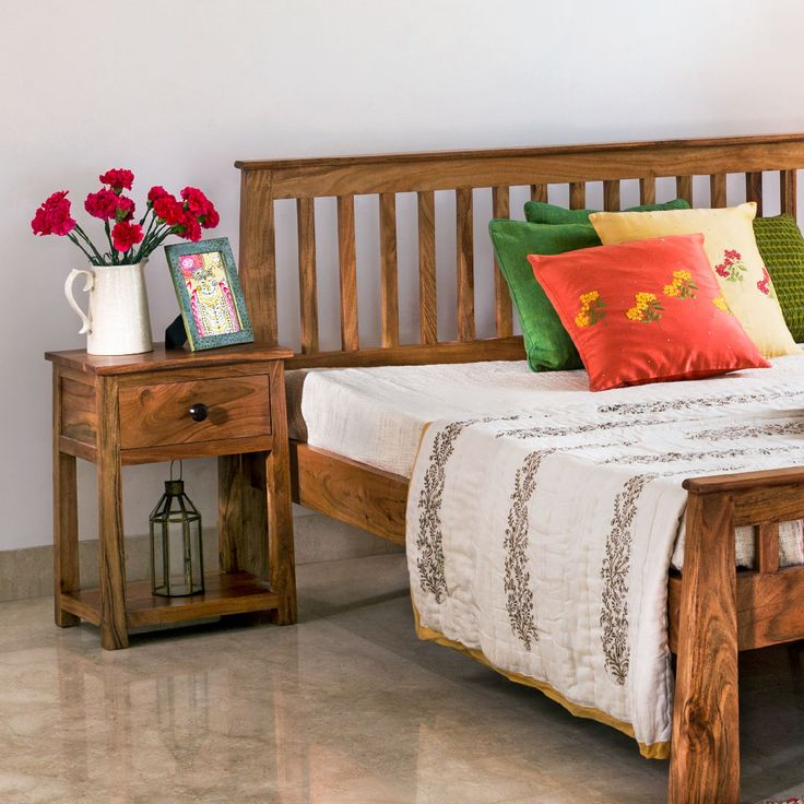 #bedroom #bed #linen #cushions #bedside #furniture #wooden #wood #decor #quilts #Fabindia #home #lifestyle