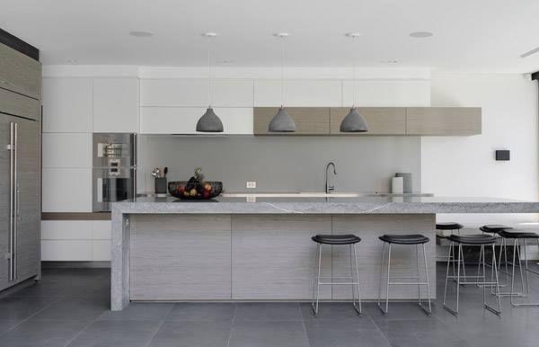heavy concrete pendant lights by benjamin hubert over an island bench. Black Bedroom Furniture Sets. Home Design Ideas