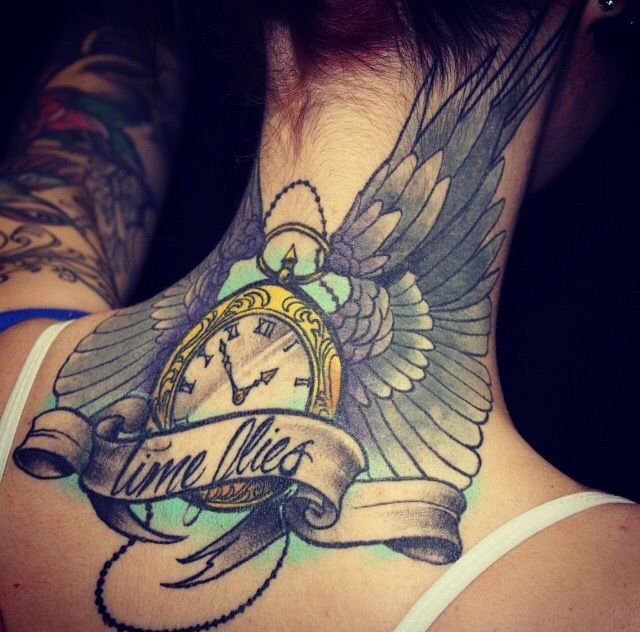 Time flies tattoo on back of he neck. Clock with wings , banner and script. Edmonton tattoo artists. Feminine tattoo