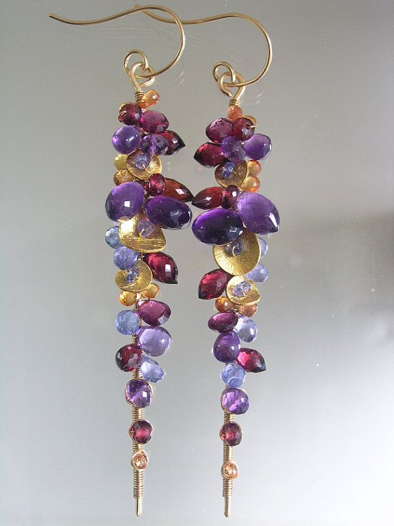 Linear dangles encrusted with amethyst, rhodolite garnet, red garnet, tanzanite and golden sapphires.
