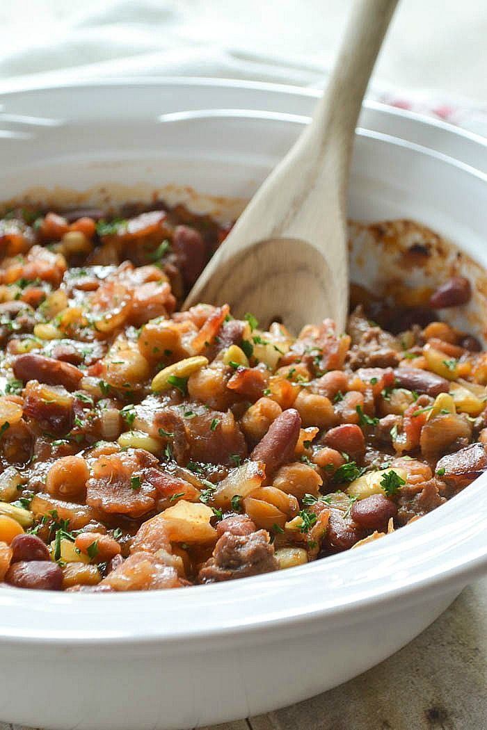 A family favorite recipe for Calico Beans mixed with a variety of beans, ground beef and bacon then tossed in a sweet and tangy sauce and baked until hot and bubbly!!