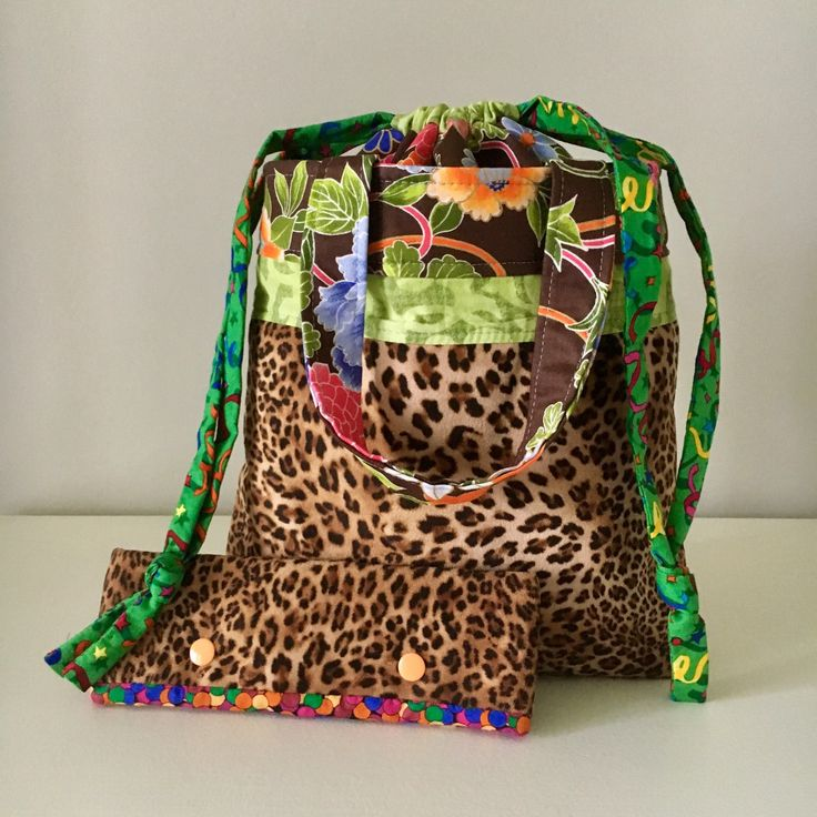 When your projects want to be cuddled in Leopard fun fur.  The QuiltMoxie drawstring project bag has interior pockets and a compartment divider to keep your projects organized.  Attach lockable stitch markers to two rings and Presto --> yarn guides!