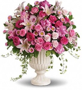 Make a grand statement with this impressive pink arrangement! Arranged in a classical urn, the pink peonies, roses, lilies and asters are a feminine, awe-inspiring tribute to the beauty of nature and true love.  Lush pink, light pink and hot pink blooms including oriental lilies, matsumoto asters, roses and peonies are accented with variegated ivy and rich green salal in a classical urn.