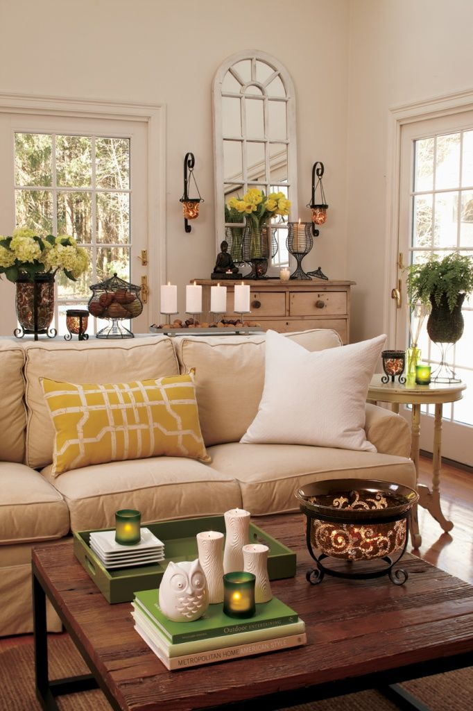 Neutral living room with pops of mustard yellow and green