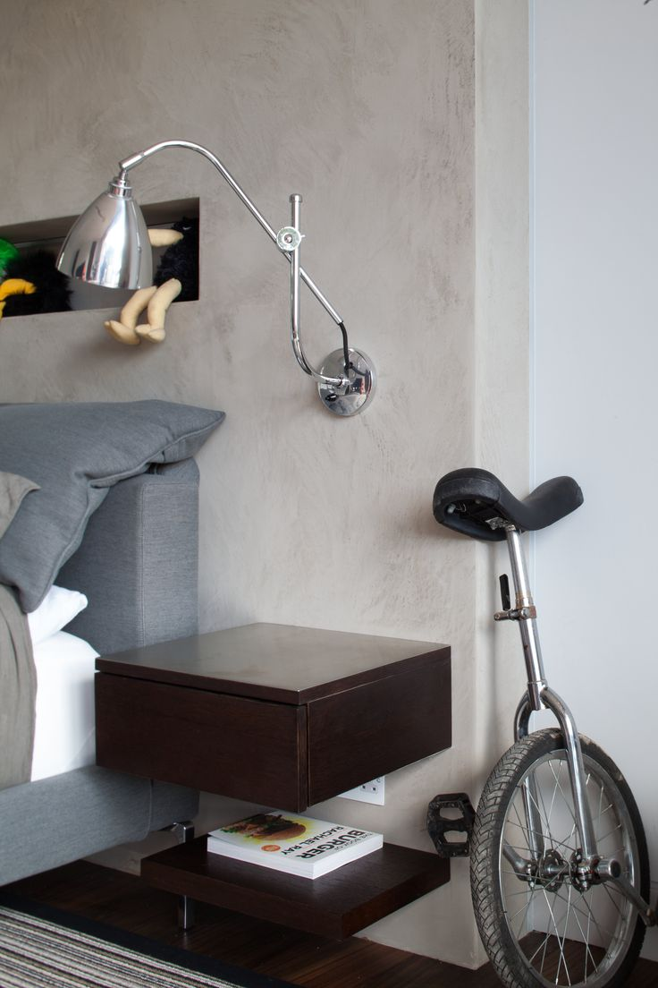 Floating bed side unit on a concrete head board.