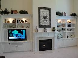 built in book cases beside fireplace with tv - Google Search