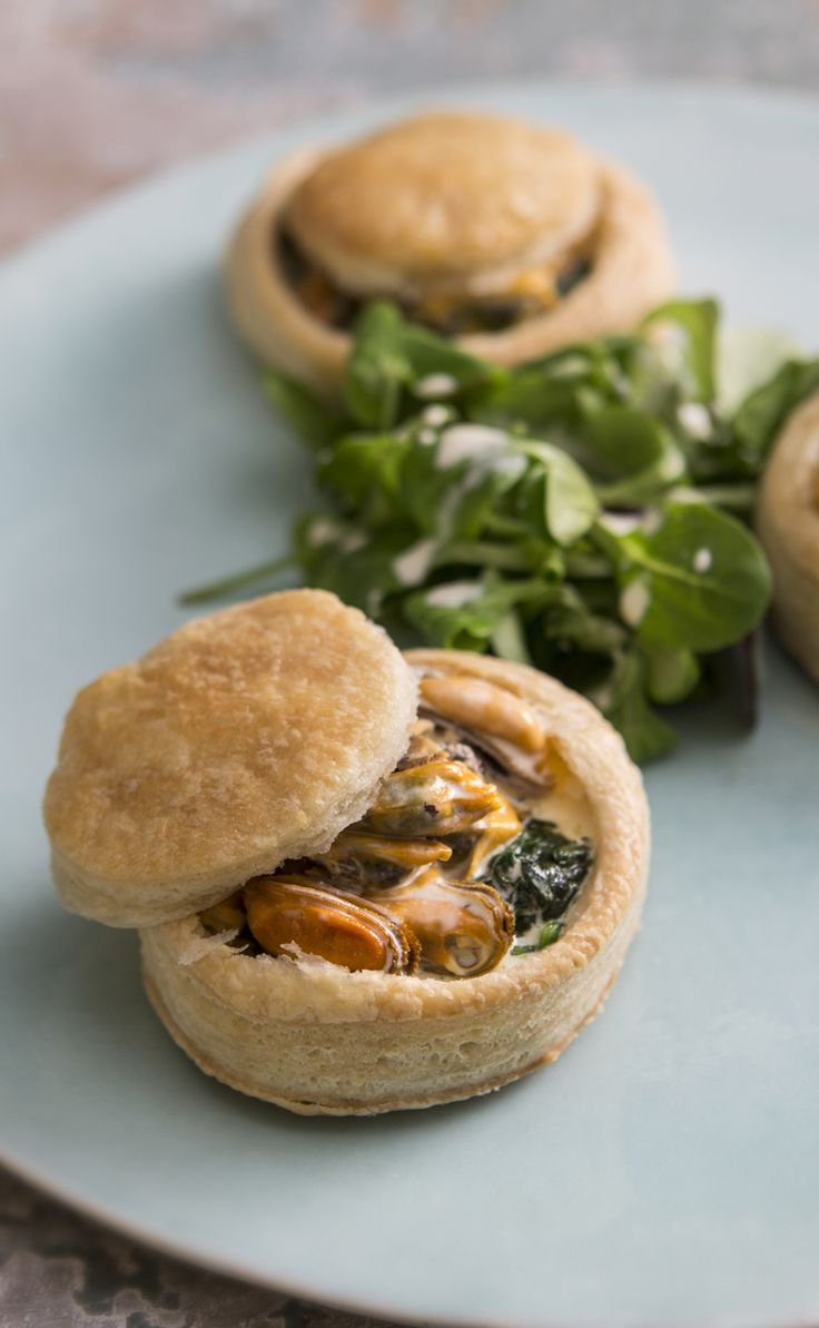 Bringing a modern twist to a retro classic, Mark Dodson's vol-au-vents have a creamy blue cheese sauce to complement the mussel filling. Don't be afraid of giving mussels a try at home – really quick to cook and make these puff pastry tarts extra special. These individual versions make a great lunch, but you could make smaller ones for canapés as well.