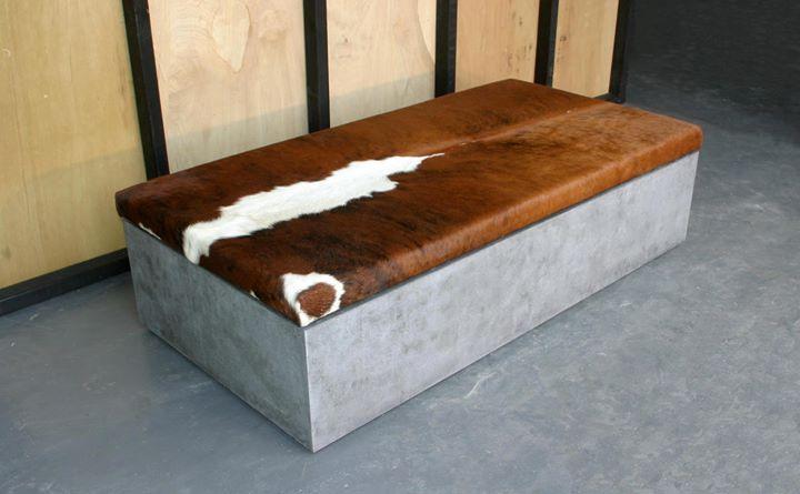 Concrete and cowhide ottoman by POPconcrete