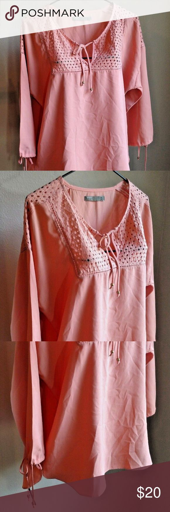"""Sfera Terra Cotta Peach Peasant Lace Boho Top Elegant boho style top is a shade of terra cotta to peach (Crayola markers added for shade reference). Fabric content tag has been removed but it feels like a poly blend. Lace inserts at yoke and shoulders. Tie front and sleeves with beads on each. Size medium by Sfera Casual measures about 23"""" flat across the bust and is about 23"""" long at the shoulder. In nice preowned condition without stains, tears, or other visible flaws. Sfera Tops Blouses"""