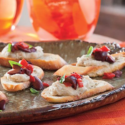 White Bean and Black Olive Crostini: Set out salty, satisfying crostini for your guest when they arrive; it's sure to set a great tone for the rest of the meal. Garnish with torn basil leaves.