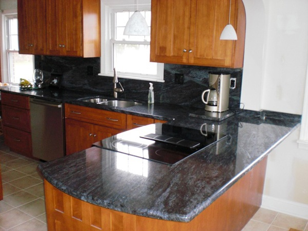 Natural cherry cabinets with bross blue granite counters More