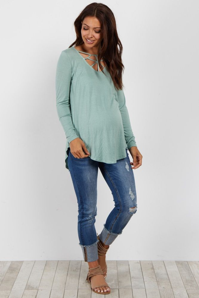 This caged front maternity top is everything you need this season. With a unique neckline and comfy long sleeves, this maternity top is the perfect piece for any transitional mom. Style this maternity top with maternity jeans and a booties for a casual chic look.