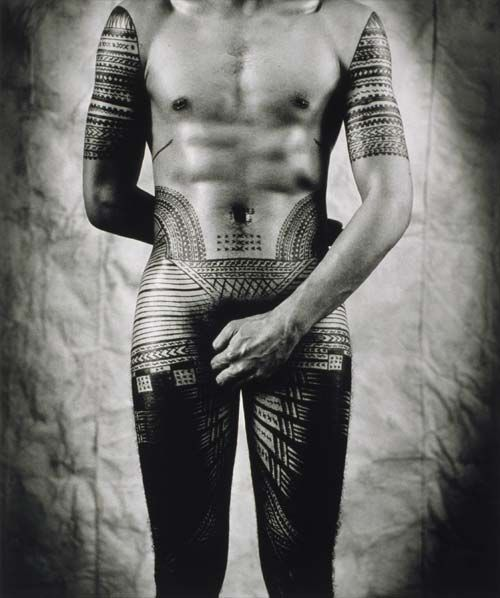 Fa'asamoa (Samoan culture) inevitably changed in New Zealand. However, many Samoans continued the traditional practice of tattooing. The pe'a tattoo, shown here in a self portrait by Greg Semu, is worn by men and normally extends from the waist to the knee. The pe'a is a very painful process which can take several weeks to complete. It is a rite of passage for Samoan males.