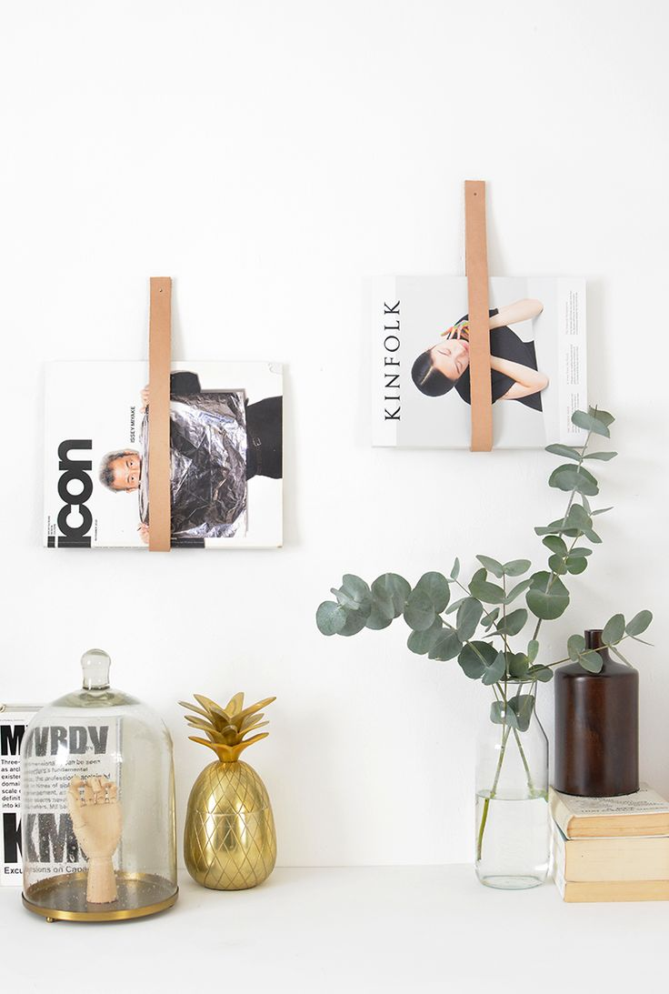DIY leather magazine rack @burkatron ..  you don't have to use them for just magazines- i think they'd be great in bathrooms for hanging towels or even useful for craft storage!