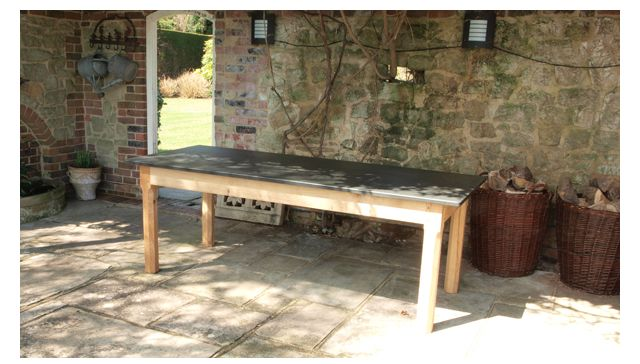 This 2.2 metre By 900mm Garden Table Had A Look Of a Banquet Table And Looked Great in The Customers Beautiful Garden www.slatetoptables.com