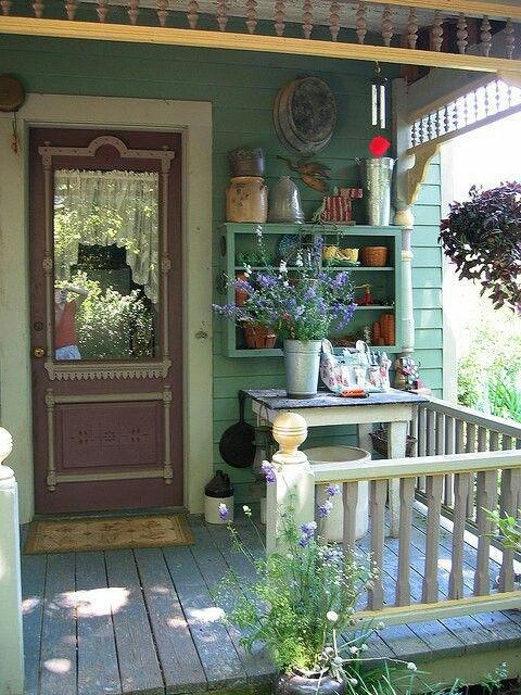 Antique door, crocks, flowers & plants for a sweet welcome