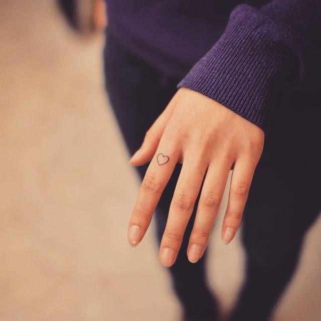 Minimalist Heart On The Index Finger Classy Tattoos Heart Tattoo On Finger Little Heart Tattoos