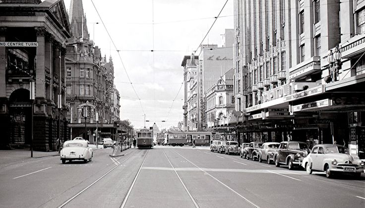 Swanston and Collins St 1959. Buildings to the south opposite the Town Hall (left) were demolished for the City Square from 1966 onwards. The Regent Theatre in Collins St. (not shown) was also intended to be demolished but was saved by a union ban. By 1968 a temporary square was installed. On the right at the Capitol Cinema Sidney Poitier was starring in what seems to be ' The Defiant Ones.' Excellent details in pic if double clicked