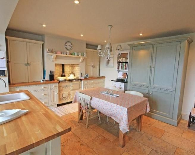 Lovely feel to this kitchen. The housekeepers cupboard is very appealing and yet…