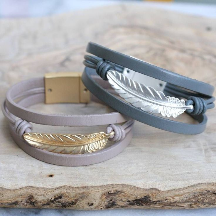 Leather Bracelet With Feather Charm. These pretty bracelets are made using strands of real leather, decorated with a gorgeous feather charm. Available in two fashionable colourways.