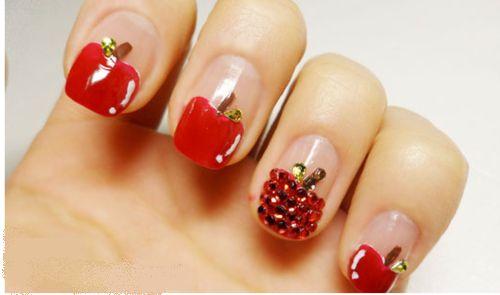 apple with rinestones nail art