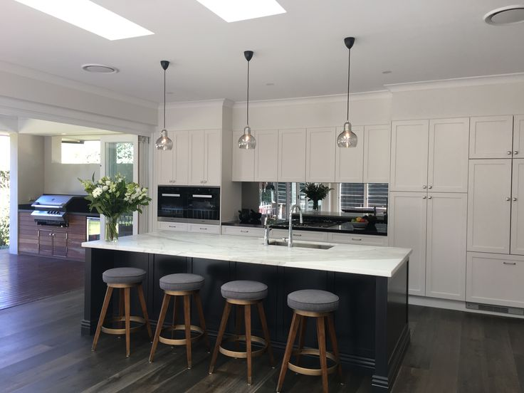 Mirrored splashback in Contemporary kitchen