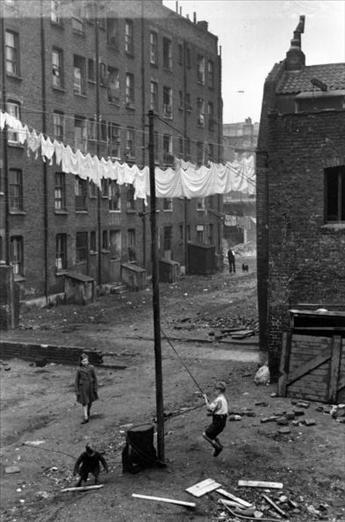 East End Slum 1949. Scary to think that my Grandpa who grew up in London would have been the same age I am now when this photograph was taken...