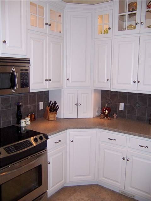 Upper Corner Kitchen Cabinet Ideas   Corner cabinets - upper, lower, and appliance garage - doors closed #homeimprovementkitchencabinets