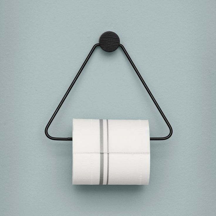 Scandinavian designed toilet paper holder in coated steel with stained ash by Ferm Living available online