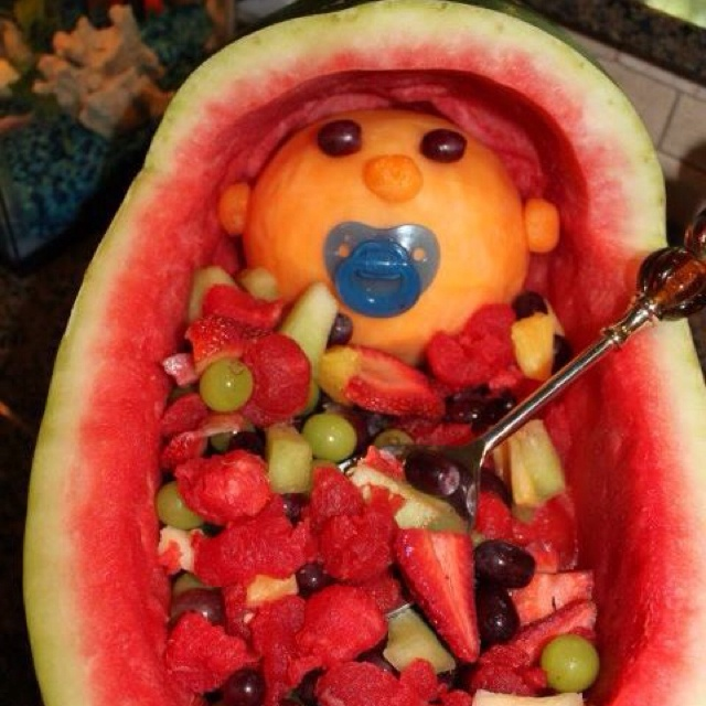 Watermelon fruit basket with baby in stroller