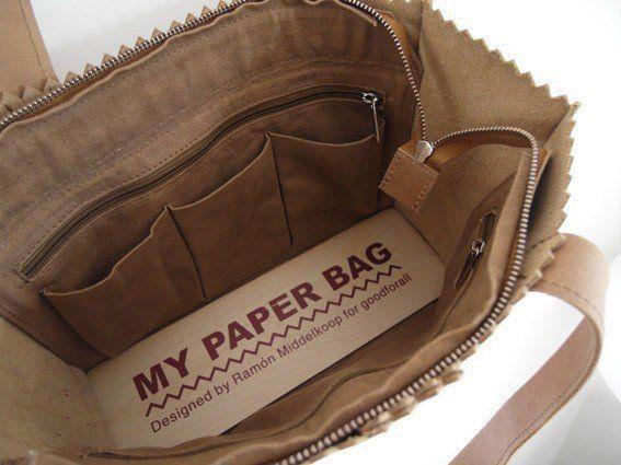 Deze handtas is schattig en stoer tegelijk.. Door de hoeveelheid vakken en praktische indeling werkt deze tas als een persoonlijke organizer. MY PAPER HANDBAG, met rits. Inclusief binnentas met rits en verschillende vakjes.Afmeting: 31 x 23 x 11 cm (let op: de handbag is de helft van de hoogte van de MY PAPER BAG)- Lengte hengsels: ca. 55 cm- Duurzaam gelooid buffelleer- Fairtrade geproduceerd- Dutch Design by Ramón Middelkoop Opgelet: enkel off black is aan promoprijs!