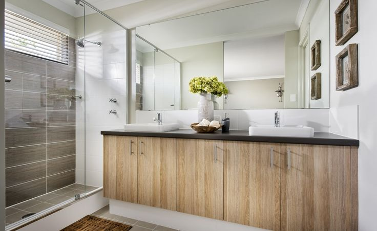 Large ensuite with twin 'His' and 'Her' vanity basins, double sized shower and seperate WC