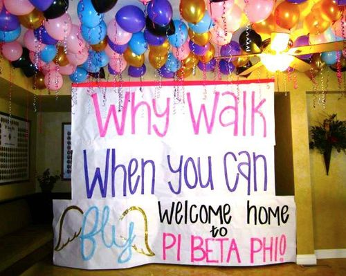 These decorations are fabulous! Welcome home the new member of pi beta phi with signs and balloons. #PBP
