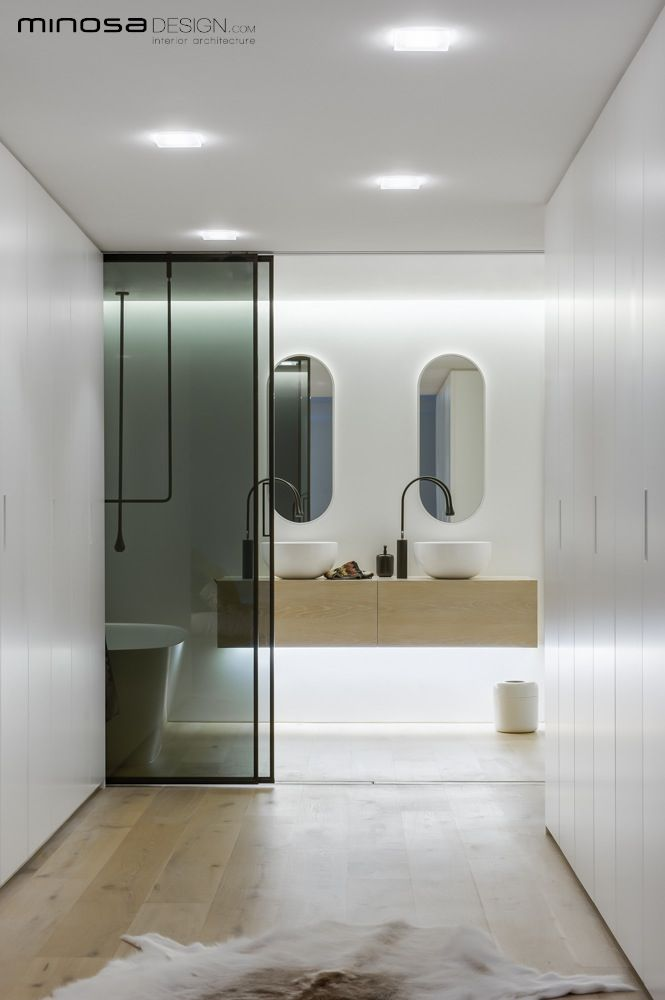 Modern White Bathroom Design In This New York Apartment! Corian® Sinks Look  Beautiful.