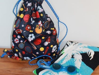 Ditch the plastic bag and use a swimming bag for going to the beach or the pool  see www.ukuchic.com