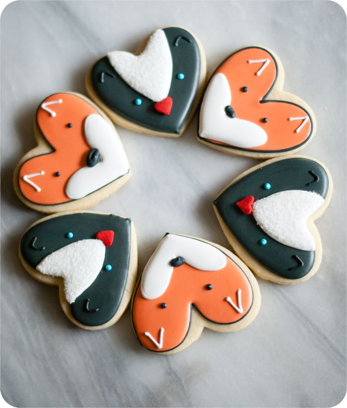 fox and skunk cookies from a heart cookie cutter, simple cookie decorating tutorials from @bakeat350