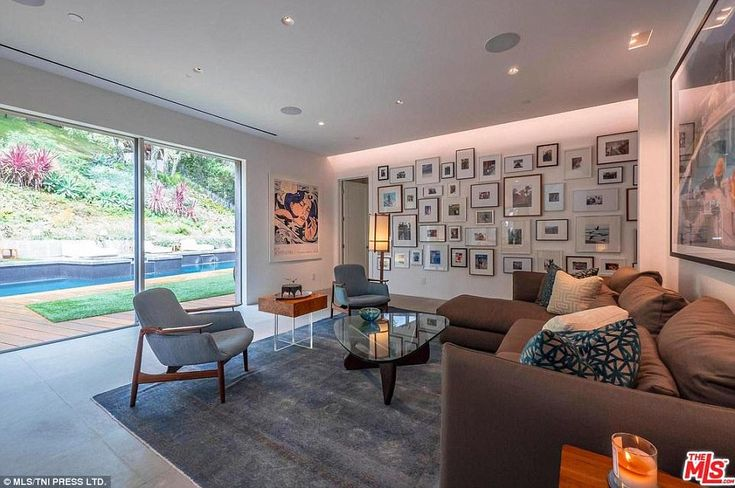 A work of art: From the comfort of the huge sofas, the lavish living room looks out onto t...