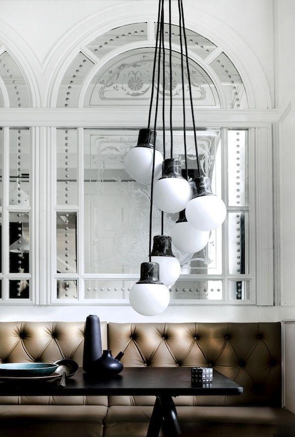 Cool globe pendant lights and amazing palladium windows/mirrors.
