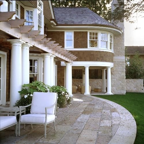 beautiful hardscape and landscape. Love the pergola and the contrast between the warm, wood shingles and the crisp white trim.