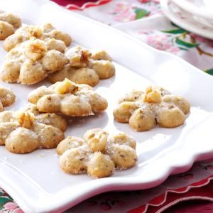 Maple-Walnut Spritz Cookies Recipe -After taking a trip to Vermont during maple harvest season, I just had to make something using maple syrup. Because I love maple, walnuts and spritz cookies, I combined all those elements to create these perfectly delicious bites. I adore the aroma when these are baking.