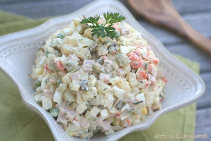 Olivye (olive-yea), Olivier salad, Oливье cалат, Ukrainian/Russian potato Salad, however you prefer to call it, is such a popular salad among the Slavic cuisine. It's well-known for its cream…