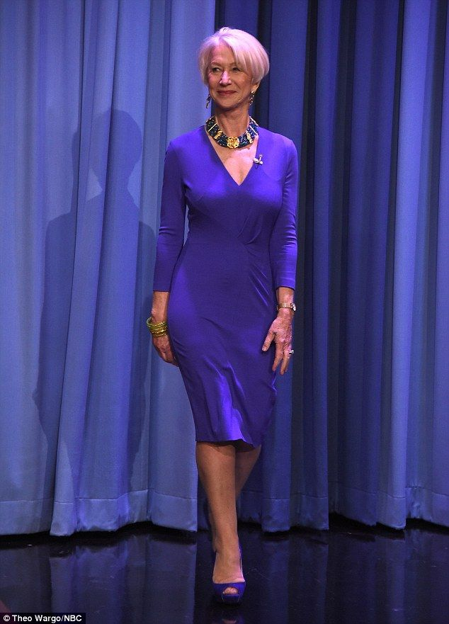 Wow factor: Helen Mirren showed off her stunning figure in a clingy purple dress and purpl...