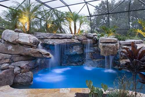 Swimming Pool with large water feature by Lucas Lagoons in Florida I want this in my back yard..